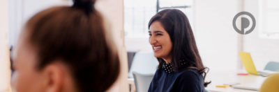 Woman smiling during meeting